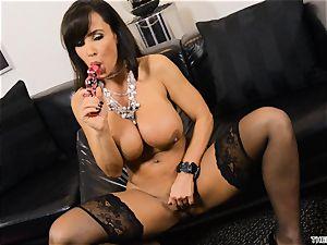Lisa Ann thrusts her fake penis deep in her moist puss