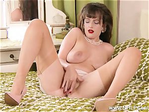 brown-haired undresses down to uncommon retro nylons fingers cooter