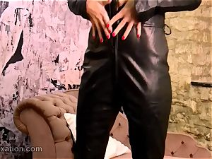 beautiful dark haired strips off leather catsuit screws toy