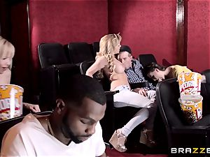 Cherie Deville and Molly Jane plow manstick in a porn theatre