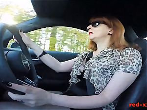 meaty hooter british mature red stroking in the car