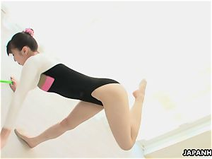 japanese gymnast fucktoys her slit and dances while unwrapping